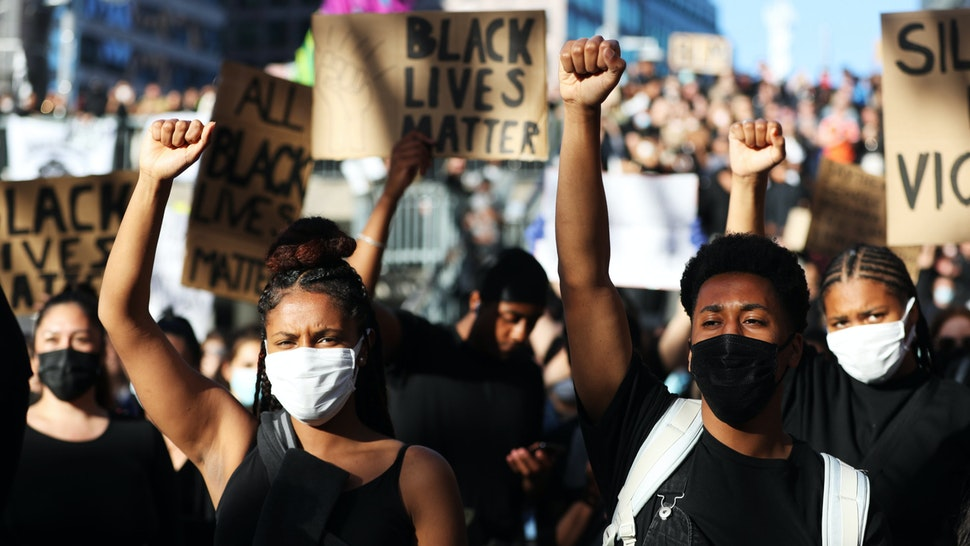 Protesters participate in a demonstration in solidarity with the Black Lives Matter movement and against police brutality at Sergels Torg on June 03, 2020 in Stockholm, Sweden.