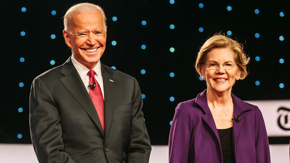 2020 Democratic presidential candidates Senator Bernie Sanders, an independent from Vermont, from left, former U.S. Vice President Joe Biden, and Senator Elizabeth Warren, a Democrat from Massachusetts, arrive on stage for the Democratic presidential candidate debate in Westerville, Ohio, U.S., on Tuesday, Oct. 15, 2019. The candidates meet for the fourth debate after an extraordinary series of events that has dramatically altered the race since the last forum in September.