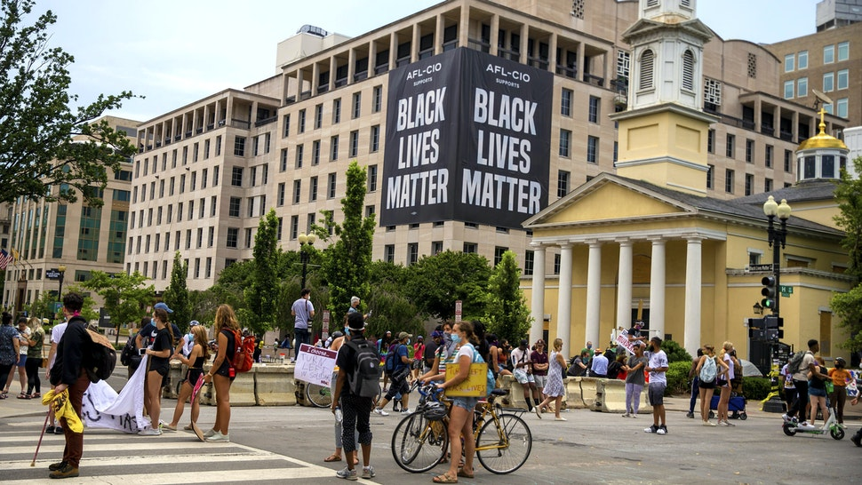 WASHINGTON, DC - JUNE 22: Protesters move items they found to block off police after the police tried to open up H Street to traffic on June 22, 2020 in Washington, DC. Protests continue around the country over the deaths of African Americans while in police custody.