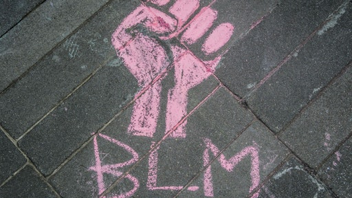 A BLM chalk graffiti seen at the protest. Hundreds of Brooklynites joined LGBTQ Youth at Barclays Center for a march across Downtown Brooklyn during Pride Month to commend Black Trans Lives Matter, demanding justice for all victims of police brutality, making also a loud call to defund the NYPD and invest in communities. (Photo by Erik McGregor/LightRocket via Getty Images)