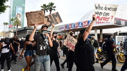Protesters march on Sunset Boulevard during a demonstration over the death of George Floyd in Hollywood, California on June 2, 2020. - Anti-racism protests have put several US cities under curfew to suppress rioting, following the death of George Floyd in police custody. (Photo by Frederic J. BROWN / AFP)