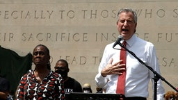 New York Mayor Bill de Blasio speaks to an estimated 10,000 people as they gather in Brooklyns Cadman Plaza Park for a memorial service for George Floyd, the man killed by a Minneapolis police officer on June 04, 2020 in New York City. Floyds brother, Terrence, local politicians and civic and religious leaders also attended the event before marching over the Brooklyn Bridge. (Photo by John Lamparski/NurPhoto via Getty Images)