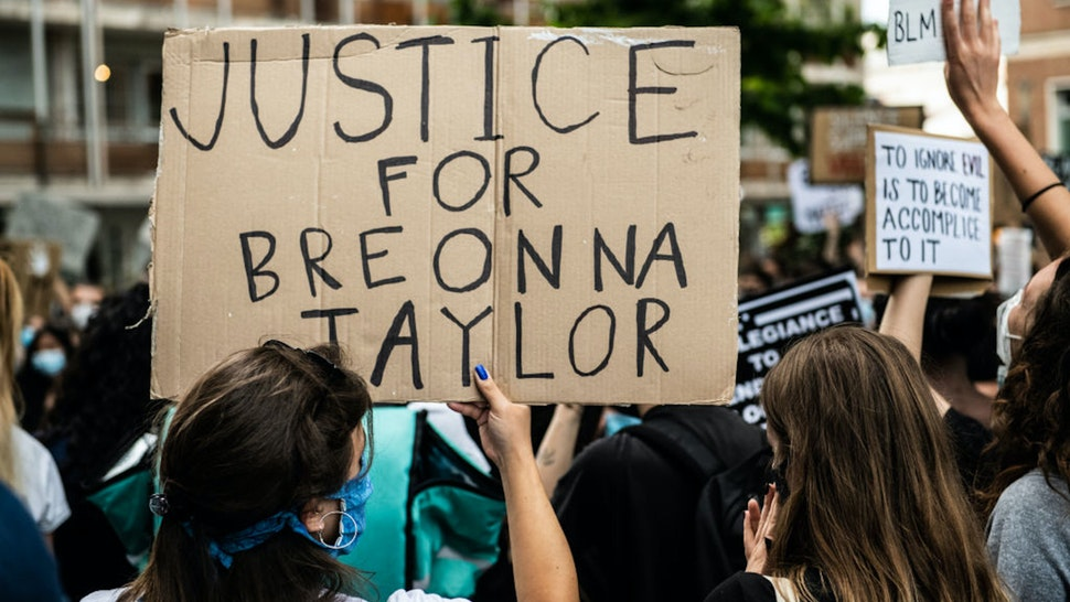 A girl holding a sign asking justice for Breonna Taylor demonstrating in Mestre, Venice, Italy on June 6, 2020, to protest the killing of George Floyd by a policeman in the USA.