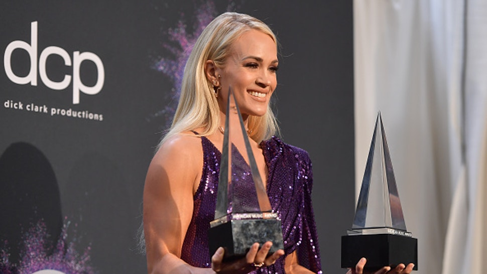 LOS ANGELES, CALIFORNIA - NOVEMBER 24: Carrie Underwood, winner of the Favorite Album - Country award for 'Cry Pretty' and Favorite Female Artist - Country award, poses in the press room during the 2019 American Music Awards at Microsoft Theater on November 24, 2019 in Los Angeles, California