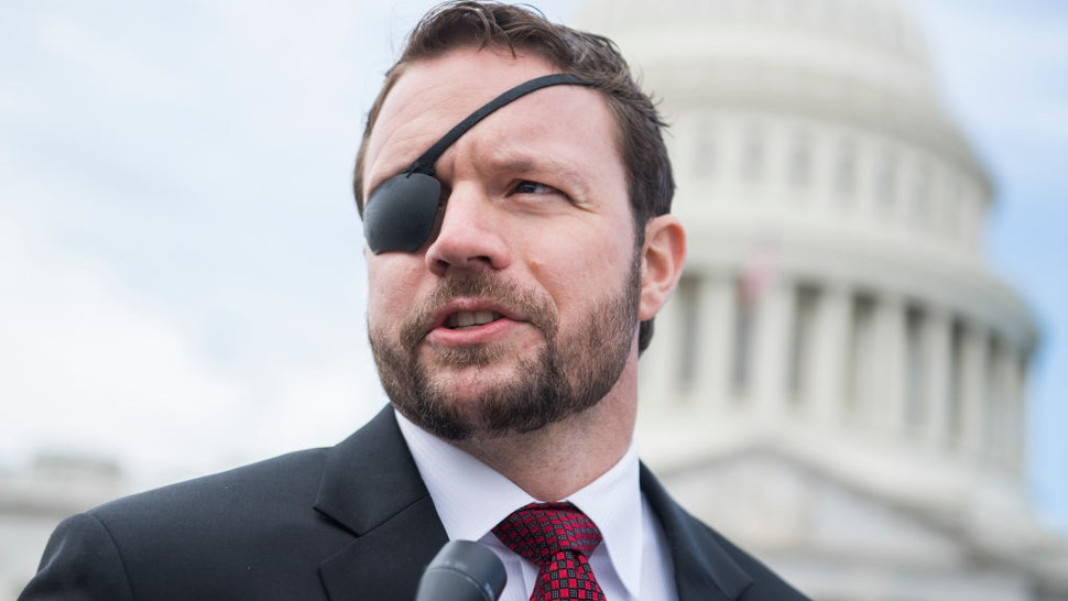 UNITED STATES - NOVEMBER 14: Rep.-elect Dan Crenshaw, R-Texas, is seen after the freshman class photo on the East Front of the Capitol on November 14, 2018. (Photo By Tom Williams/CQ Roll Call)