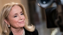 """Rep. Debbie Dingell (D-MI) speaks with MSNBC to discuss U.S. President Donald Trump's comments about her late husband, former Rep. John Dingell (D-MI), at the U.S. Capitol on December 19, 2019 in Washington, DC. President Trump suggested Dingell was """"looking up"""" from hell during a campaign rally in Michigan on Wednesday. (Photo by Sarah Silbiger/Getty Images)"""