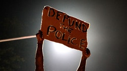 Demonstrators gather for staging a protest after an Atlanta police officer shot and killed Rayshard Brooks, 27, at a Wendy's fast food restaurant drive-thru Friday night in Atlanta, United States on June 14, 2020. As nationwide protests slowed in the death of George Floyd, anger again erupted Saturday in the US over the fatal shooting of another black man. Mayor Keisha Lance Bottoms announced Atlanta Police Chief Ericka Shields voluntarily stepped down from the department earlier in the day. (Photo by Ben Hendren/Anadolu Agency via Getty Images)