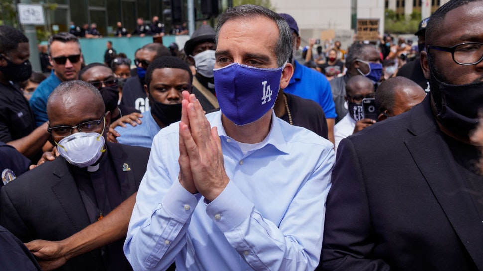 LOS ANGELES, CA - JUNE 02: LA Mayor Eric Garcetti walks out to address protesters and clergy members from the Los Angeles area that are participating in a march and peaceful protest in downtown Los Angeles outside of LA City Hall and LAPD Headquarters on Tuesday, June 2, 2020 in Los Angeles, CA. Protests erupted across the country, with people outraged over the death of George Floyd, a black man killed after a white Minneapolis police officer pinned him to the ground with his knee. (Kent Nishimura / Los Angeles Times via Getty Images)