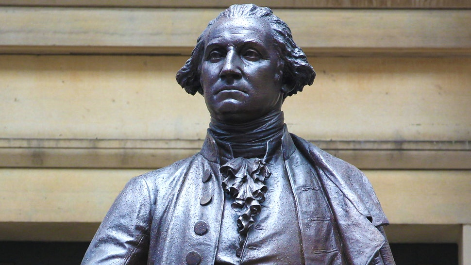 The Bronze statue of George Washington on the front steps of Federal Hall in Wall Street, Manhattan, New York City. John Quincy Adams Ward's 1882 bronze statue of George Washington sits at the approximate site where he was inaugurated as President and where he took the oath of office as the first President of the United States. New York City, USA. 16th September 2014.