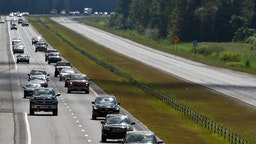 Motorists stream down I-40 westbound as the eastbound road is empty as the evacuation of the North Carolina coast continues in advance of Hurricane Florence near Suttontown, N.C. Wednesday, Sept. 12, 2018.