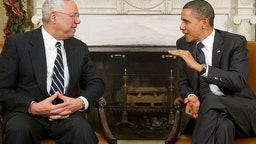 US President Barack Obama speaks with former US Secretary of State General Colin Powell (L) during a meeting in the Oval Office of the White House in Washington, DC, December 1, 2010