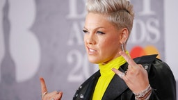 US singer-songwriter Pink poses on the red carpet on arrival for the BRIT Awards 2019 in London on February 20, 2019.