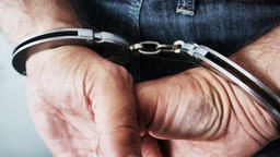 Cropped Hands Of Man With Handcuffs - stock photo