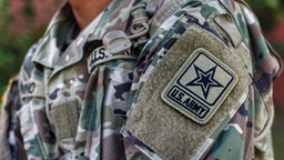 Midsection Of Man Wearing Military Uniform - stock photo