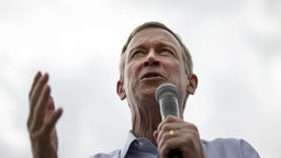 John Hickenlooper, former governor of Colorado and 2020 presidential candidate, speaks at the Des Moines Register Soapbox during the Iowa State Fair in Des Moines, Iowa, U.S., on Saturday, Aug. 10, 2019.