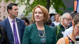 Jenny Durkan, mayor or Seattle, walks through the crowd at City Hall during the Global Climate Strike in Seattle, Washington, U.S., on Friday, Sept. 20, 2019. Thousands of workers at Microsoft Corp. and Amazon.com Inc. walked out without their bosses blessings to protest rising global temperatures. Photographer: Chloe Collyer/Bloomberg via Getty Images