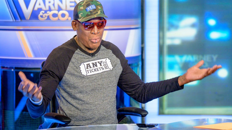 """Former NBA Basketball player Dennis Rodman visits """"Varney & Co."""" with guest-host David Asman at Fox Business Network Studios on September 18, 2019 in New York City."""