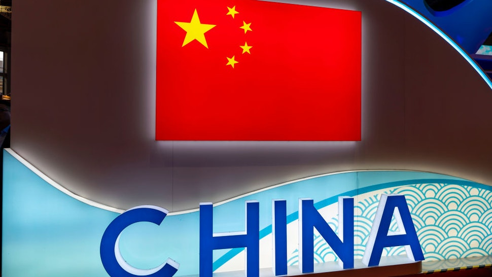 Symbol of China and China's flag are pictured during the 2nd China International Import Expo (CIIE) at the National Exhibition and Convention Center on November 6, 2019 in Shanghai, China.
