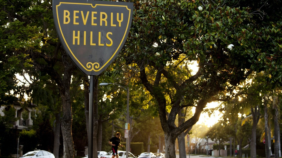 The official seal of the city of Beverly Hills is displayed on a sign in Beverly Hills, California, U.S., on Tuesday, July 26, 2011. Global sales of luxury goods may rise 8 percent in 2011 excluding currency swings as demand strengthens in the U.S. and Europe and emerging-market shoppers splurge, Bain & Co. estimated in May. Photographer: Konrad Fiedler/Bloomberg via Getty Images