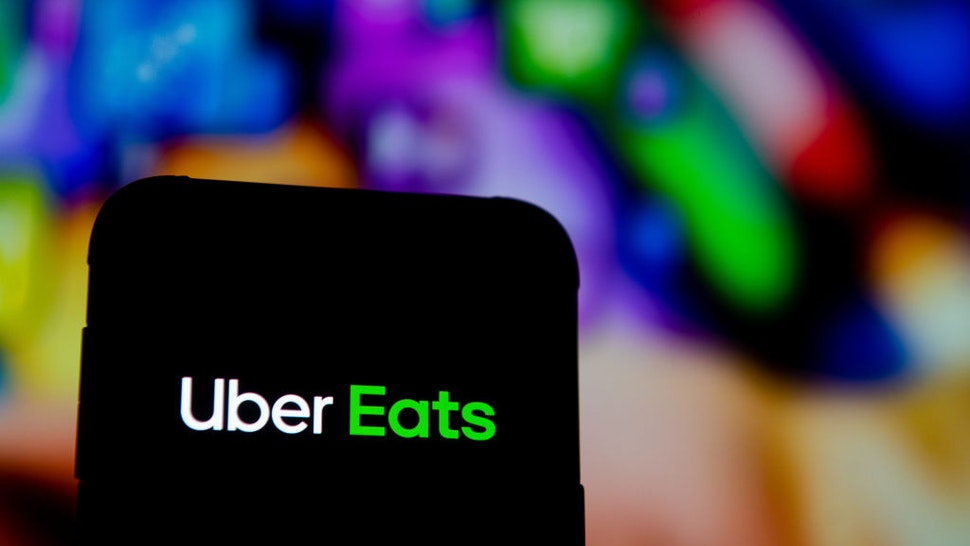 In this photo illustration an Uber Eats logo seen displayed on a smartphone.