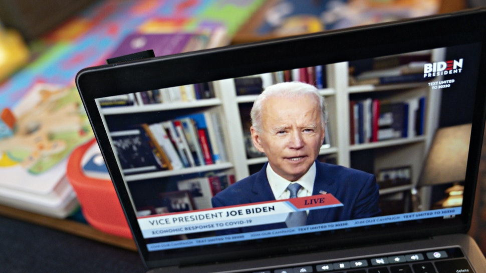 Former Vice President Joe Biden, presumptive Democratic presidential nominee, speaks during a virtual event seen on an Apple Inc. laptop computer in Arlington, Virginia, U.S., on Monday, April 13, 2020. Senator Bernie Sanders endorsed Biden during the joint livestream saying that Americans of all political affiliations should back the former vice president. Photographer: Andrew Harrer/Bloomberg via Getty Images
