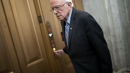 WASHINGTON, DC - MARCH 18: U.S. Sen. Bernie Sanders (I-VT) arrives at the U.S. Capitol for a vote on March 18, 2020 in Washington, DC. Senate Majority Leader Mitch McConnell is urging members of the Senate to pass as soon as possible a second COVID-19 funding bill already passed by the House. (Photo by Win McNamee/Getty Images)