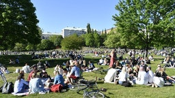 People enjoy the sunny weather in Tantolunden park in Stockholm on May 30, 2020, amid the novel coronavirus pandemic.