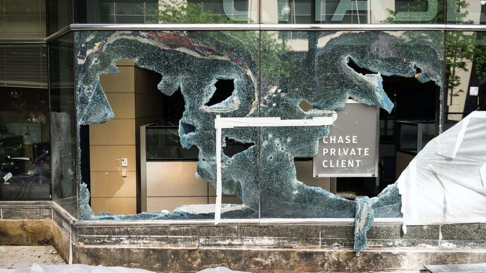 The windows of a Chase Bank are seen shattered in Downtown Chicago on May 31, 2020. On Saturday, thousands of demonstrators in Chicago protested the killing of George Floyd by Minneapolis Police. By the evening, looting and destruction of property spread throughout the city center. (Photo by Max Herman/NurPhoto via Getty Images)