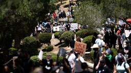 People at a gathering setup by groups Black Lives Matter Los Angeles and Build Power that started at Pan Pacific Park and went through the Fairfax District on Saturday, May 30, 2020 in Los Angeles, CA.