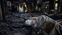 mannequin is seen on the floor of a burned commercial building in Downtown Long Beach, California on Jun
