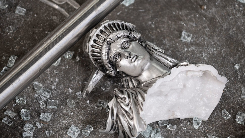 "TOPSHOT - A broken Statue of Liberty figure is seen between glass shatters outside a looted souvenir shop after a night of protest over the death of an African-American man George Floyd in Minneapolis on June 2, 2020 in Manhattan in New York City. - New York's mayor Bill de Blasio yesterday declared a city curfew from 11:00 pm to 5:00 am, as sometimes violent anti-racism protests roil communities nationwide. Saying that ""we support peaceful protest,"" De Blasio tweeted he had made the decision in consultation with the state's governor Andrew Cuomo, following the lead of many large US cities that instituted curfews in a bid to clamp down on violence and looting. (Photo by Johannes EISELE / AFP) (Photo by JOHANNES EISELE/AFP via"