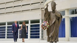 U.S. President Donald Trump and First Lady Melania Trump visit the Saint John Paul II National Shrine in Washington, D.C., U.S., on Tuesday, June 2, 2020.