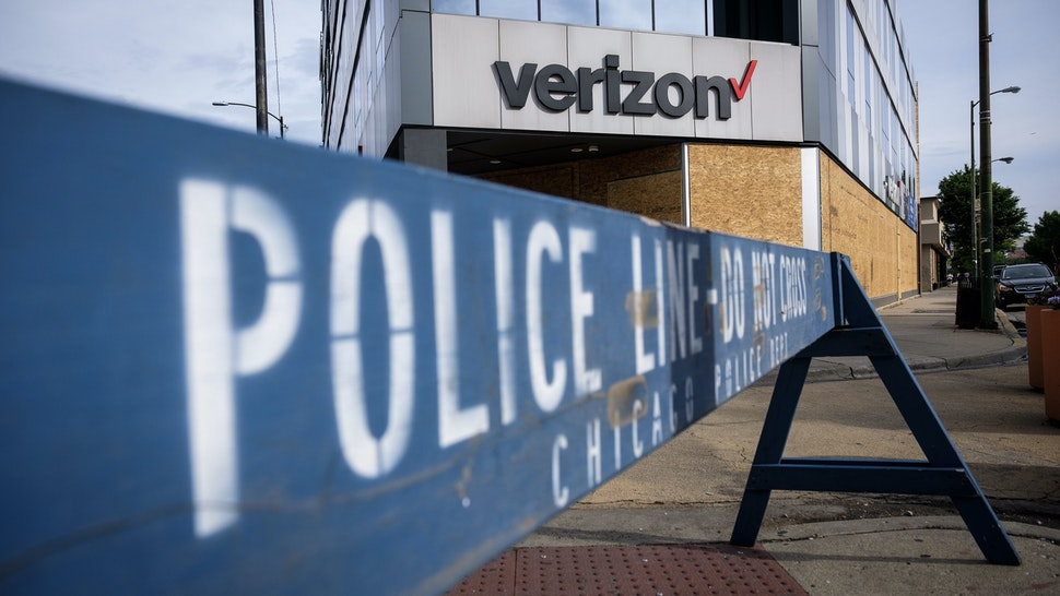 A police barricade stands in front of a boarded up Verizon store in Chicago, Illinois, U.S., on Friday, June 5, 2020. Protesters have come out in droves across the U.S. tospeak outagainst the killing of George Floyd and though they have been largely peaceful, some people have used the unrest as an opportunity to vandalize andlootstores in many cities. Photographer: Christopher Dilts/Bloomberg via Getty Images
