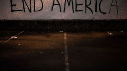 Graffiti is seen on a wall after demonstrators clashed with law enforcement near the Seattle Police Departments East Precinct shortly after midnight on June 8, 2020 in Seattle, Washington.