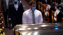 J.J. Watt of the NFL Houston Texans pauses at the casket bearing the remains of George Floyd in the chapel during his funeral service at the Fountain of Praise church June 9, 2020 in Houston, Texas.