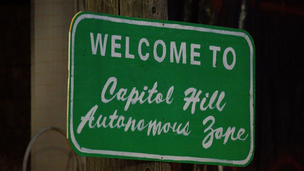 """SEATTLE, WA - JUNE 10: A sign welcomes visitors to the so-called """"Capitol Hill Autonomous Zone"""" on June 10, 2020 in Seattle, Washington. The zone includes the blocks surrounding the Seattle Police Departments East Precinct, which was the site of violent clashes with Black Lives Matter protesters, who have continued to demonstrate in the wake of George Floyds death. (Photo by David Ryder/Getty Images)"""