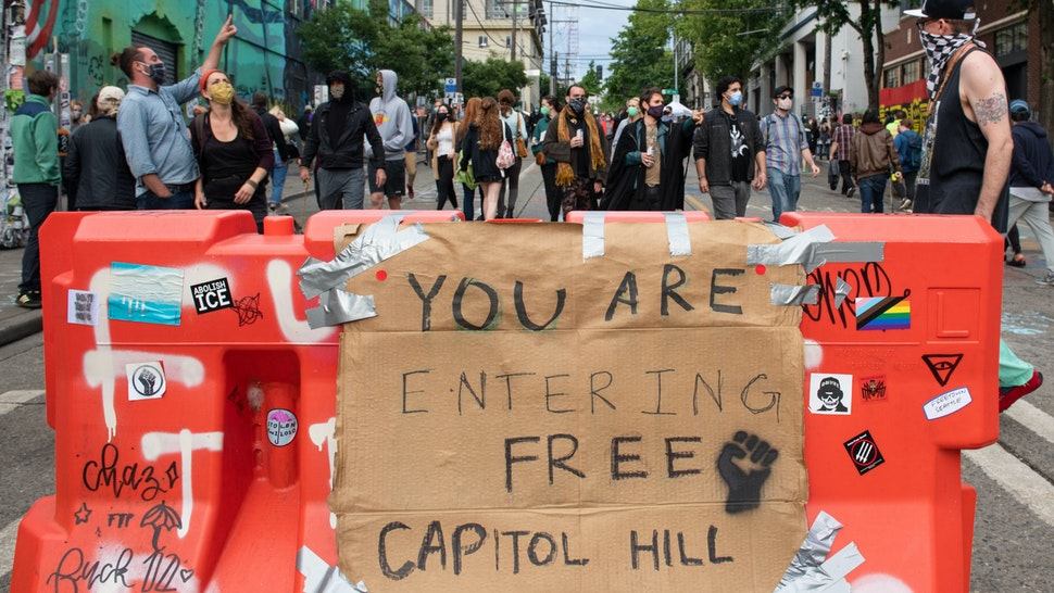 SEATTLE, WASHINGTON - JUNE 12: A sign inside the âCapitol Hill Autonomous Zoneâ in Seattle, Washington on June 12, 2020. The area named âAutonomous Zoneâ was formed after Seattle Police abandoned its East Precinct during protests against police brutality and the death of George Floyd, an unarmed black man who died after being pinned down by a white police officer in Minneapolis, Minnesota, United States on May 25, 2020. (Photo by Noah Riffe/Anadolu Agency via Getty Images)
