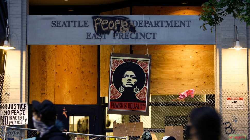 An image of activist Angela Davis is displayed above the entrance to the Seattle Police Department's East Precinct, vacated June 8, and now surrounded by streets reopened to pedestrians forming an area named the Capitol Hill Autonomous Zone (CHAZ) in Seattle, Washington on June 12, 2020.