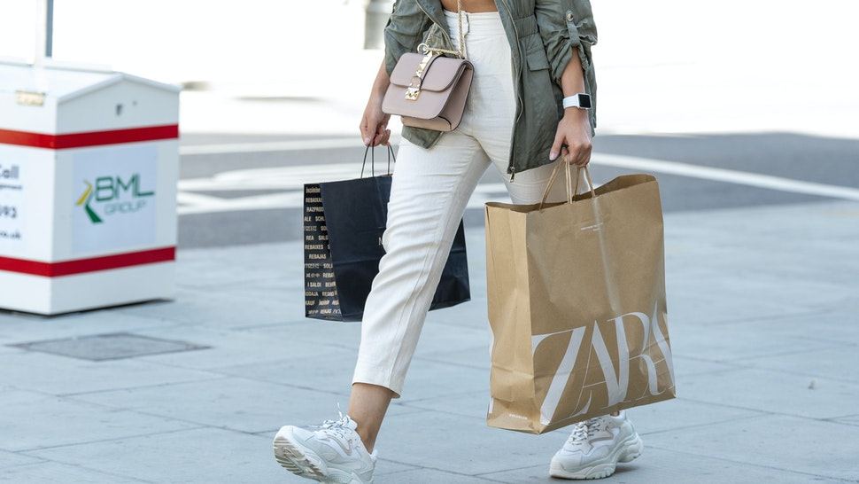 LONDON, UNITED KINGDOM - 2020/06/15: A shopper carries Zara shopping bags on Londons Oxford Street after the shops were allowed to reopen. (Photo by Dave Rushen/SOPA Images/LightRocket via Getty Images)