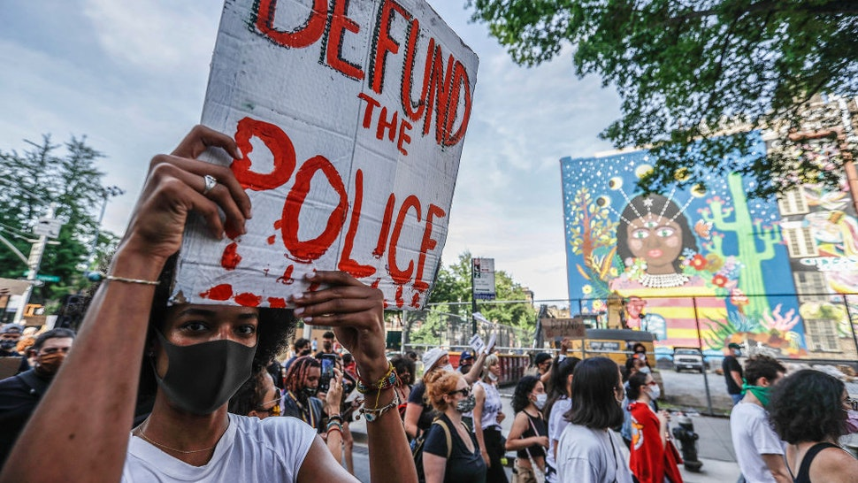 A demonstrator holds a placard during the protest. Protests continue against police brutality and racial injustice in New York City.