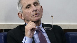 WASHINGTON, DC - APRIL 22: Dr. Anthony Fauci (R), director of the National Institute of Allergy and Infectious Diseases, participates in the daily coronavirus task force briefing at the White House on April 22, 2020 in Washington, DC. Dr. Robert Redfield, director of the Centers for Disease Control,has said that a potential second wave ofcoronavirus later this year could flare up again and coincide with flu season. (Photo by Drew Angerer/Getty Images)