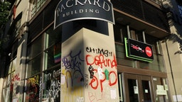 The Packard Building, an apartment building inside Seattle's so-called Capitol Hill Autonomous Zone, is seen being damaged and vandalized.