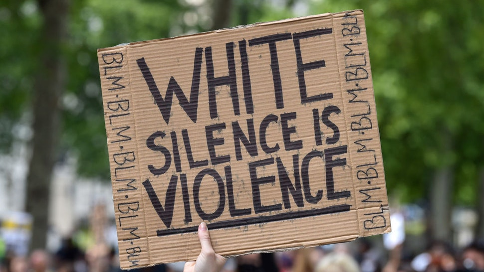 A Black Lives Matter protester holds a placard saying White Silence is Violence during the demonstration. Black Lives Matter protests continue in the United Kingdom after the death of George Floyd killed by a police officer in Minneapolis.