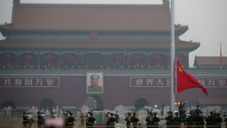 Chinese People's Liberation Army (PLA) officers attend the flag-raising ceremony at Tiananmen Square on the International Workers' Day on May 1, 2020 in Beijing, China.