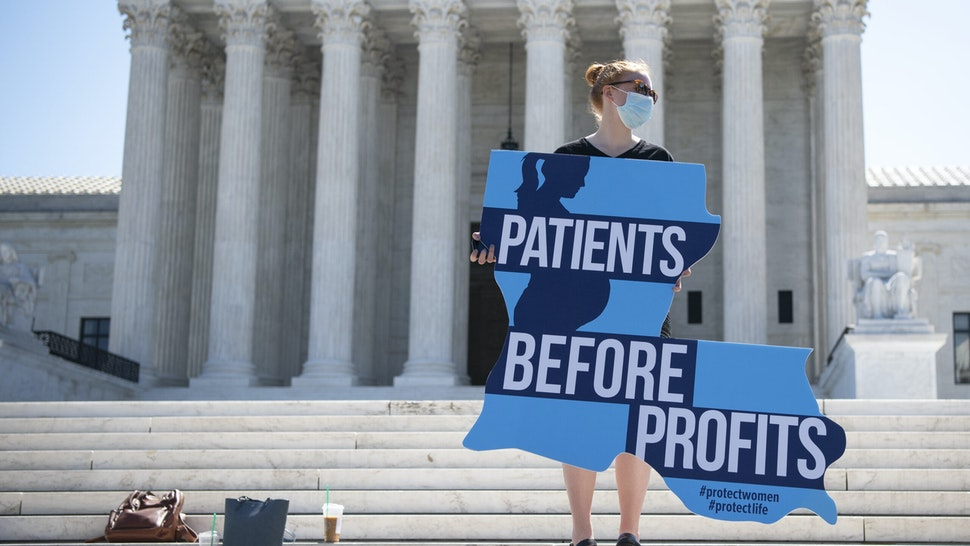 UNITED STATES - JUNE 29: An anti-abortion demonstrator holds a sign as she and others protest in front of the Supreme Court after a decision was made to strike down a Louisiana law regulating abortion clinics in Washington on Monday, June 29, 2020. (Photo by Caroline Brehman/CQ-Roll Call, Inc via Getty Images)