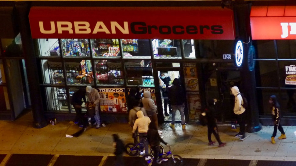 Looters enter a store during protests against the death of George Floyd, in the South Loop of Chicago, Illinois, May 31, 2020.