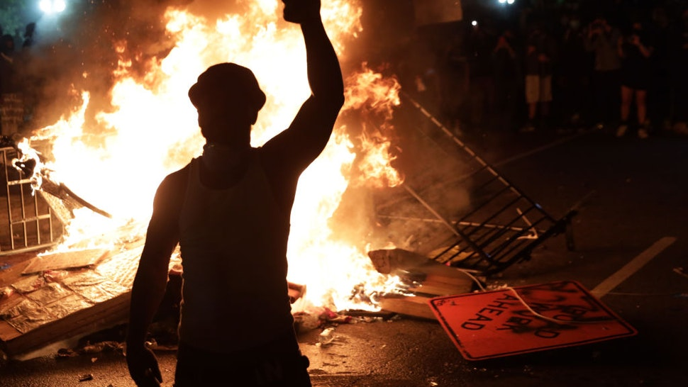 Demonstrators stand around a fire during a protest near the White House in response to the killing of George Floyd May 31, 2020 in Washington, DC.