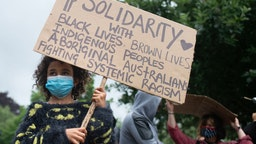 A child holds a anti-racism sign during a Black Lives Matter protest on June 11, 2020 in Newport, United Kingdom.