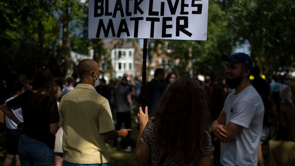 People protest during a Black Lives Matter rally in Newington Green on June 13, 2020 in London, England.