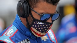 Bubba Wallace, driver of the #43 Victory Junction Chevrolet, stands on the grid prior to the NASCAR Cup Series GEICO 500 at Talladega Superspeedway on June 22, 2020 in Talladega, Alabama.